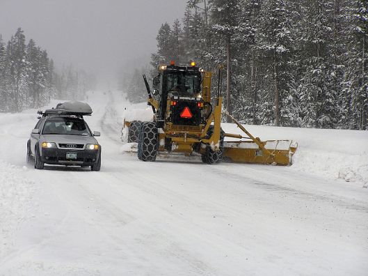 This is in Oregon, but we have the same sorts of plows here. (And fewer towering evergreens. ;) )
