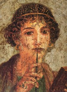 A portrait of a young woman (so-called Sappho) with writing pen and wax tablets uncovered in Pompeii.