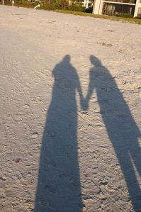 Holding_Hands_shadow_on_sand