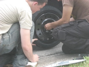 2007_film_crew_for_Truth_in_Numbers_changing_tire_on_rental_car