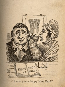 V0011264 A woman shouting into a man's ear-trumpet. Wood engraving.
