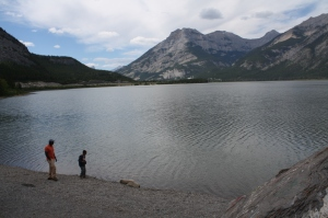 Mr. Johns and our son throwing rocks into a mountain lake. Still en route.