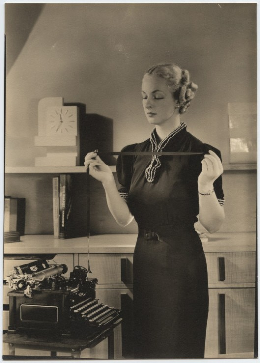 Woman_holding_typewriter_ribbon_at_Royal_Typewriter_(7009492745)
